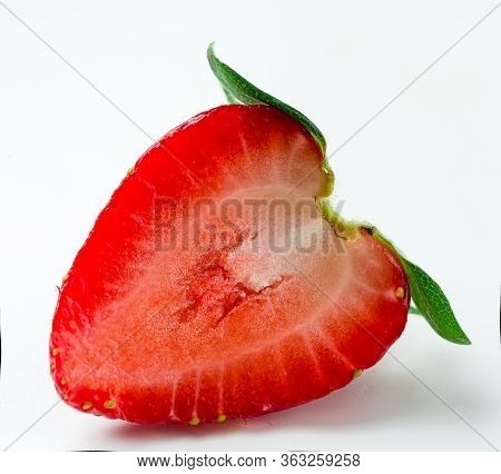 Fresh Half Strawberries Were Placed On A White Background. Professional Studio Macro Red Slice Straw