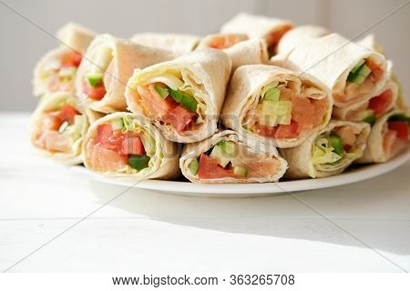Pita Salmon Rolls With Cucumbers, Tomatoes And Letuce. Asian Style Rolls Made With Tortilla And Fres