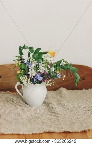 Countryside Bouquet. Spring Wildflowers In Vintage Cup On Rustic Wooden Table. Blooming Colorful Flo