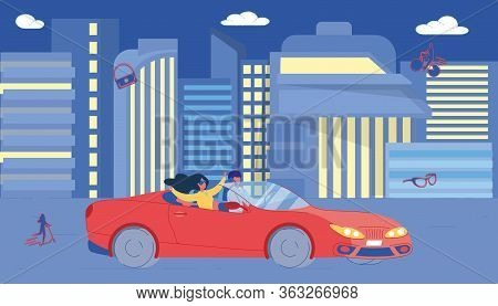 Happy Couple Driving Red Convertible Car Luxury Vehicle On Night Street. Man And Woman Enjoying Nigh