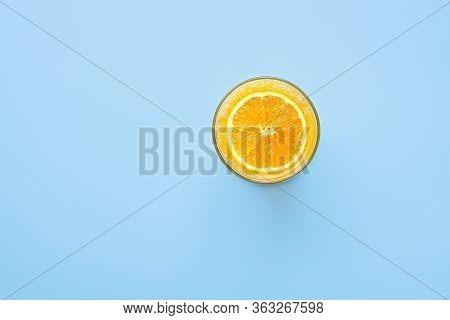 Freshly Pressed Citrus Orange Juice With Fruit Slice In Glass On Blue Background Background. Summer