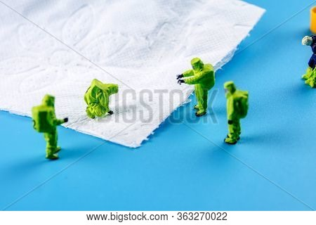 A Team Of Miniature Figurines Checking A Cleanliness Of Toilet Paper, Very Important To Make A Desin