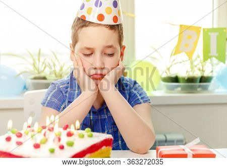 Sad Child Crying At Birthday Party. Birthday Party Alone At Home