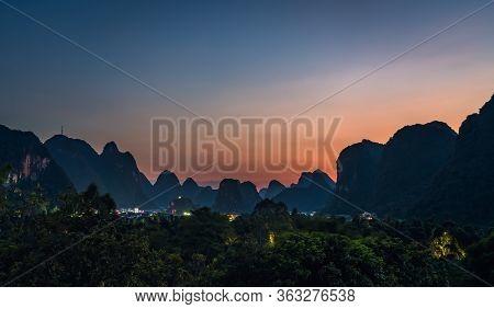 Beautiful Impressive Karst Mountain Landscape In Yangshuo At Dusk, Guangxi Province, China