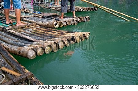 Close Up Of Bamboo Rafts For Carrying Tourists Steered By Guides On Scenic And Beautiful Yulong Rive
