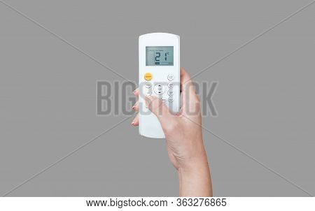 The Process Of Pressing The Air Conditioner On A Gray Background