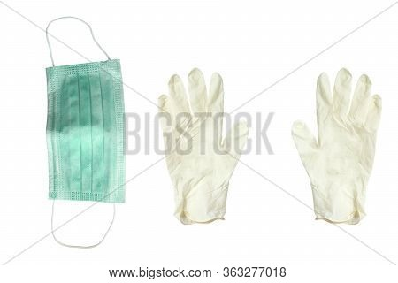 Respiratory Mask For Face And Rubber Gloves On A White Background
