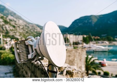 Outdoor Wi-fi Antenna In The City. 3g And 4g Communication. Coverage Of The Mobile Operator. A White
