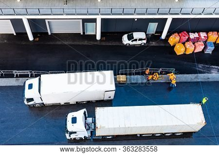 Asphalt Road At Shipping/ Shipment Delivery Port. White 10 Ten Wheeler Freight Truck And 18 Eighteen
