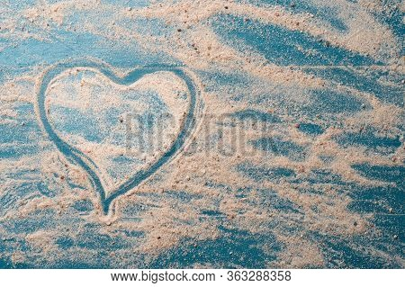 Golden Beach Sand With Heart Shape On A Blue Wood Background. Summer Travel Love Concept Backdrop. C