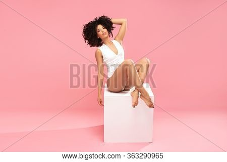 Afro Girl With Ideal Body On Pink Background.