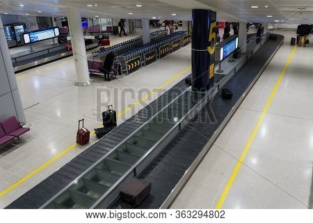 Manchester, Uk - February 19 2020: Uk Airport Baggage Reclaim Area. Manchester Airport Terminal Arri