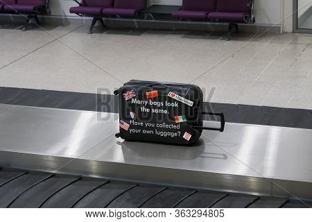 Manchester, Uk - February 19 2020: Uk Airport Baggage Reclaim Area Security Reminder. Manchester Air