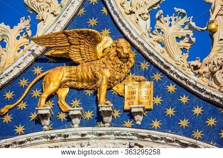 The pediment is decorated with a golden winged Lion - the emblem of Venice. San Marco Cathedral - architectural masterpiece in the Byzantine style. The concept of cultural and photo tourism