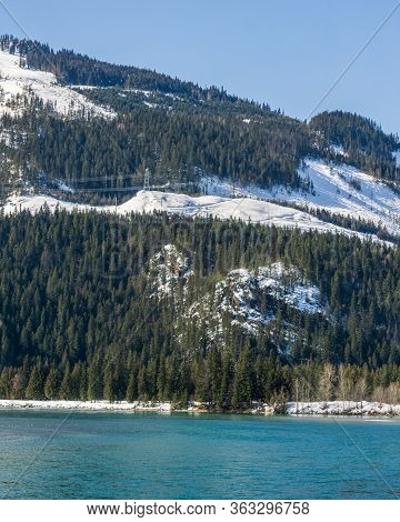Green Forest On The Mountains With Snow Near Columbia River British Columbia Canada