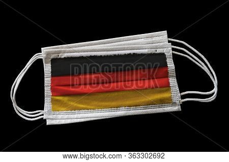 3d Rendering Of Surgical Face Masks With Germany Flag Printed. Isolated On Black Background. Concept