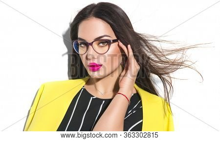 Fashion Model woman in glasses. Business wear look style, Beauty sexy model girl in trendy yellow blazer wearing glasses, isolated on white background. Beautiful young brunette lady, makeup.