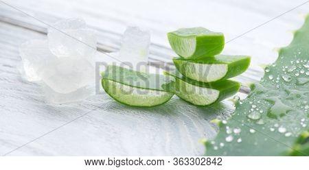 Aloe Vera gel closeup. Sliced Aloevera natural organic renewal cosmetics, alternative medicine. Organic Skin care concept. Isolated On white background. Aloe Vera close-up