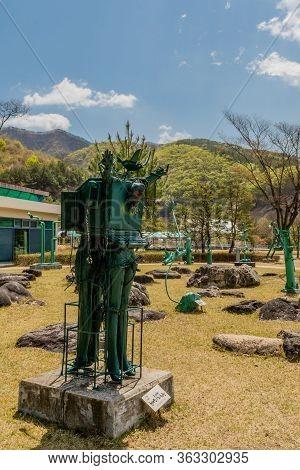 Jinan, South Korea; April 21, 2020: Green Metal Sculpture Located At Yongdam Dam Reservoir Park. Art