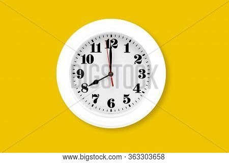 Modern Wall Clock White Isolated On Yellow Background, Time And Period, Office Timepiece And Mockup