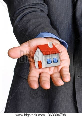 Real estate agent seller give the house on hand concept.