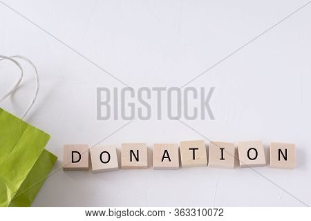 Word Donation And Donation Package On A White Background. Food For Donations. Food Delivery. Food Ai