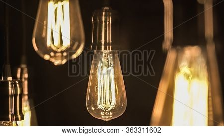 Vintage Style Light Bulbs Hanging From The Ceiling. Old Edison Bulb.