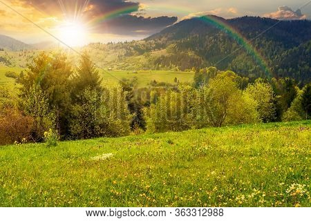 Beautiful Rural Landscape In Mountains At Sunset. Countryside Scenery On An Overcast Weather In Spri