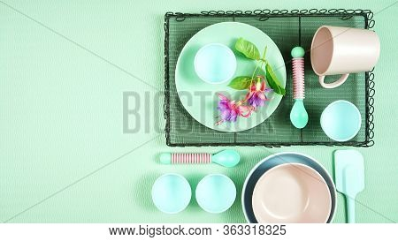 Modern Pastel Pink, Green And Blue Ceramic Tableware Set On Pale Green.