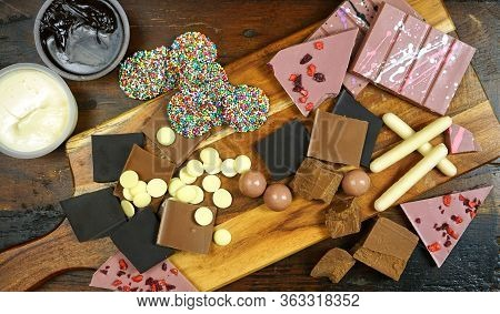 Cooking With Chocolate Concept With Raw Chocolate Ingredients On Chopping Board.