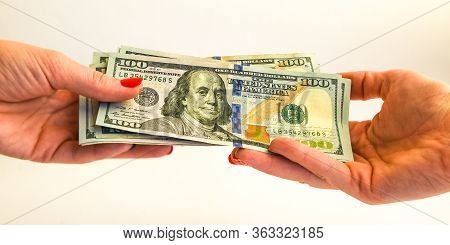 Transfer Of Money, Hand With Banknotes 100 Dollar, Usd Notes As Background The United States Dollar