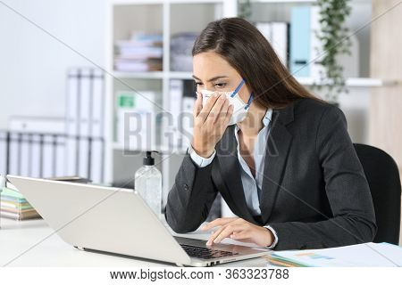 Executive Exposing Herself To Contagion Touching Protective Mask Working At Office