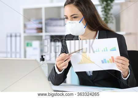 Happy Executive Woman With Protective Mask Shows Growth Graph Report On Videocall On Laptop At The O