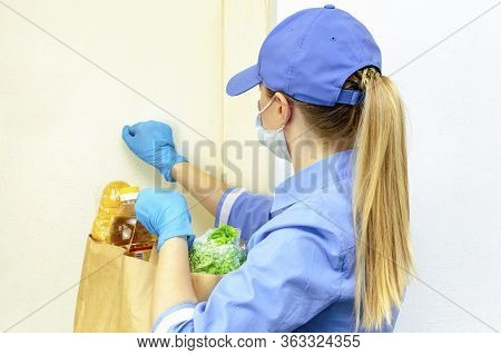 Donation, Quarantine Support, Coronavirus. Volunteer Young Blonde Woman In A Uniform And A Medical M