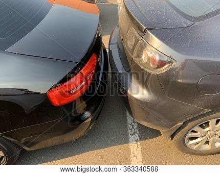 Two Cars Next To Each Other. Cars Are Parked Very Close. Small Clearance From Bumper To Bumper. Kiev