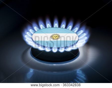 Burning Gas Burner Of A Home Stove In The Middle Of Which Is The Flag Of The Country Of Argentina. G