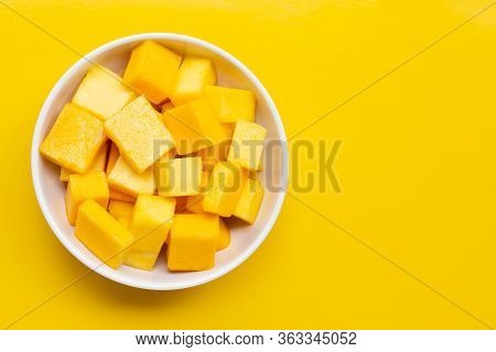 Tropical Fruit, Mango Cube Slices In White Bowl On Yellow Background. Copy Space