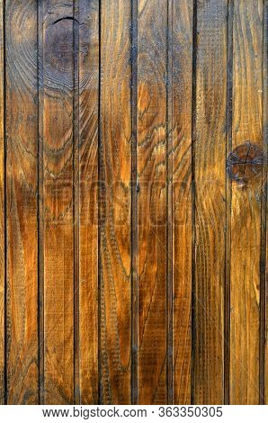 Varnished Boards. Wooden Shield Made Of Yellow Varnished Boards. The Natural Basis For A Variety Of