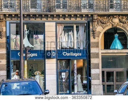 Paris, France - July 8, 2006: Show Windows Of Marillages Bridal Shop Of Wedding Dresses In Classical