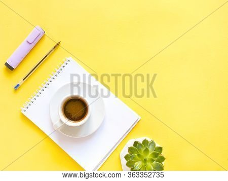 Flat Lay Composition With Notebook, Pen, Coffee, Plant On Yellow Background. Concept Remote Study An