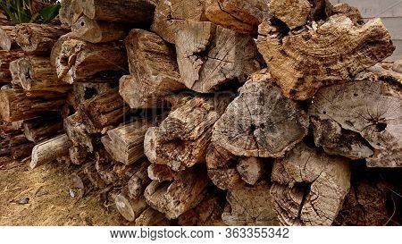 Heaps Of Old Teak Wood Damaged By Corrosion
