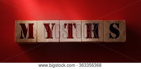 Myths Word On Wooden Blocks. True And False Facts, Fake Or Real News Concept