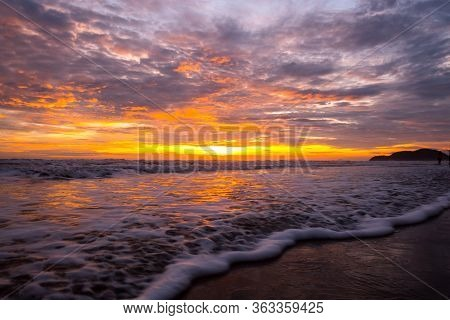 Reflection Of Vivid Sunset Sky Over Sea And Beach.colorful Sunrise With Clouds Over Ocean,chanthabur