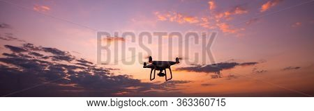 Panorama Drone Quadcopter With Digital Camera Flying At Sunset.dark Flying Drone And Cloud Sunrise S