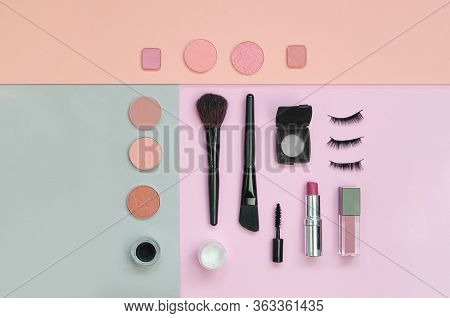 Colorful Cosmetics Lying On Pink And Yellow Background. Makeup Set. Flatlay Background For Design