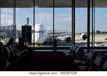 Paris, France - November 2, 2018: Long Range Airliner Plane Waiting In Front Of An Airport Seen From