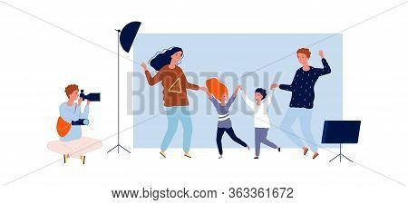 Happy Family Time. Parents With Kids In Photo Studio With Professional Photographer. Isolated Happy