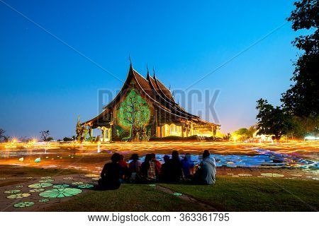 Candle Lights From People Walk Around Amazing Temple At Twilight Time,thailand.thai Temple With Grai
