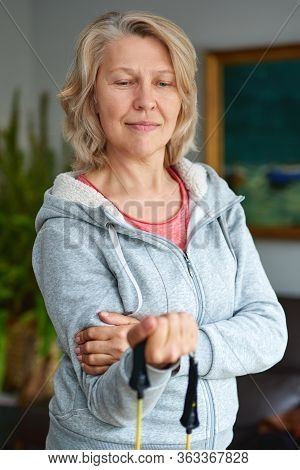 Biceps Training.active Senior Woman At Home Exercising With Weights. Mature Woman Exercise At Home.