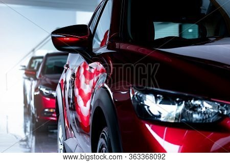 Red Suv Car Parked In Modern Showroom. New And Luxury Suv Compact Car. Car Dealership Concept. Autom
